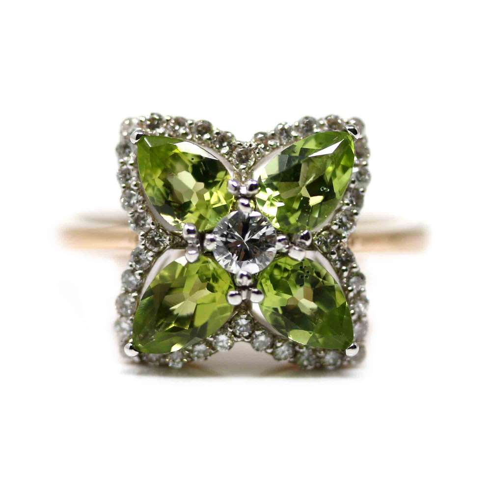 18kte White gold and pink gold ring with brilliants and peridots
